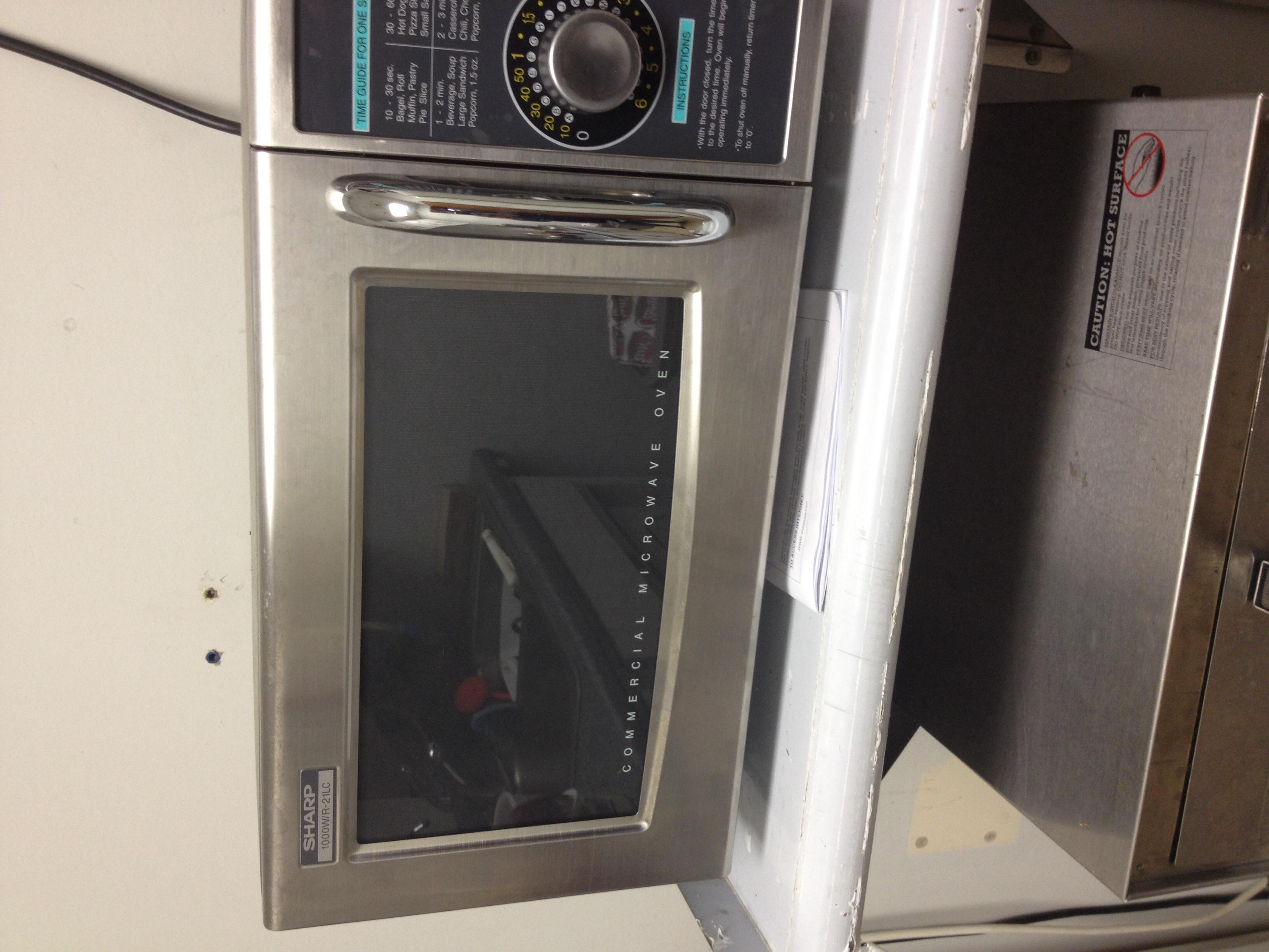 ... Sharp 1000W R-21LCF Microwave w/ Dial Timer 1.0 Cu. Ft. Interior